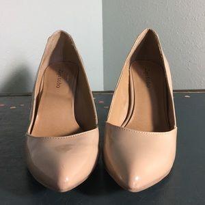 Nude, pointed heels
